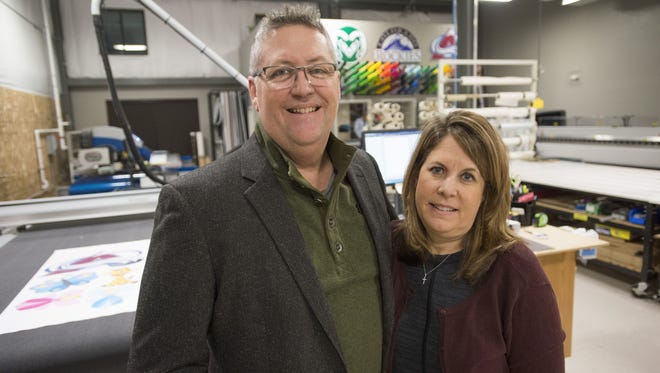 Pete and Cheryl Thomas stand in their Fort Collins business, Signs Now, after it was repaired following a 2013 arson. Digital Print Resources recently moved into the Riverside Avenue building.
