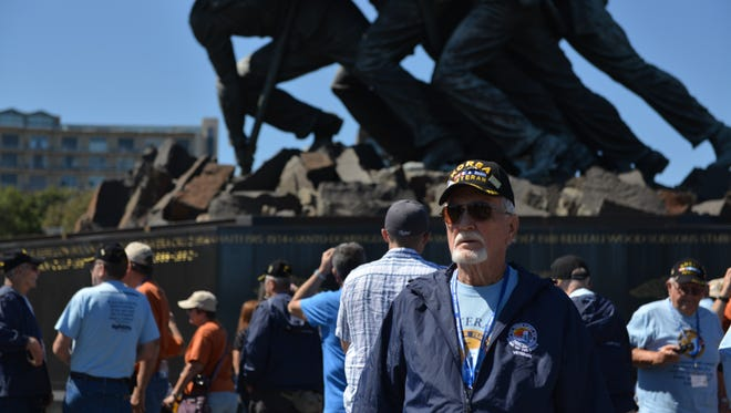 Michael Kennedy, former aerial photographer in the Korean War, visits Marine Corps War Memorial during September 2015 trip by Honor Flight Northern Colorado.