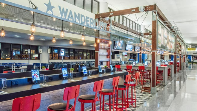 Satiate your beer and burger cravings at Wanderlust Burger Bar in Newark's Terminal C.