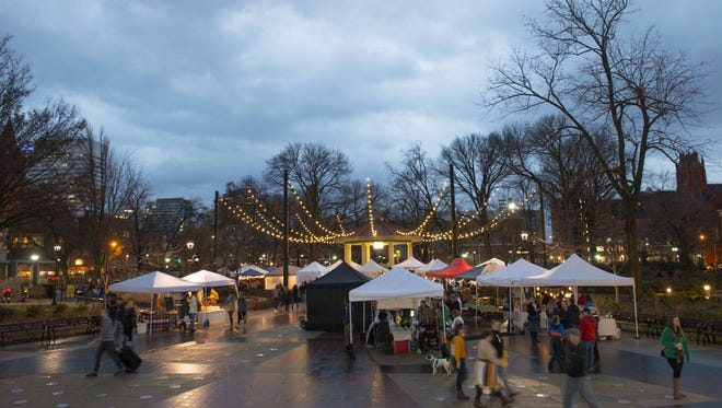 City Flea Unwrapped Holiday Market at Washington Park in OTR featured vendors, shops and food.  When you enter into Washington Park vendors set up around the gazebo to make the shopping a quick and easy task.