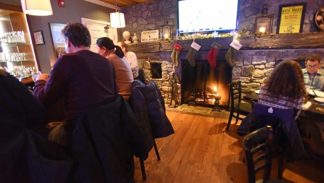 Guests enjoying one of the six fireplaces ablaze  at Ho Ho Kus Inn.