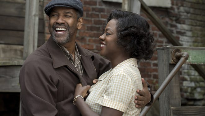 "Denzel Washington (left) and Viola Davis star in ""Fences,"" a film adaptation of a Tony-winning August Wilson play."