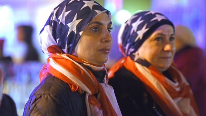 Aziza Suleiman and Sahar Jelahej look on as protesters rally to build solidarity amongst all communities. and against president Trump's executive order on travel ban.