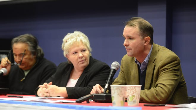Susan Davis, center, pictured at a December 2015 panel discussion alongside T.J. Donovan,  asked the Vermont House of Representatives to consider a recount in her November 2016 election.