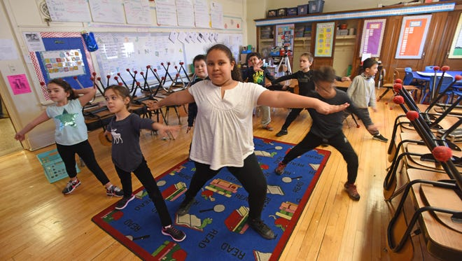 """Second graders participate in the """"cosmic kids, Yoga class"""" after school program at School 6 in Cliffside Park Trump's proposed budget includes the elimination of $1.2 billion in funding to 21st Century Learning Centers, which include more than 50 after school and summer programs in NJ"""