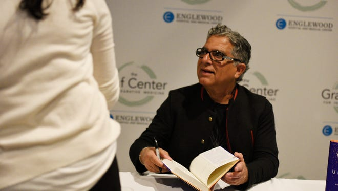 Deepak Chopra, an alternative medicine pioneer, speaks to a fan after signing a copy of his book at Bergen Performing Arts Center in Englewood on Friday, March 24, 2017.