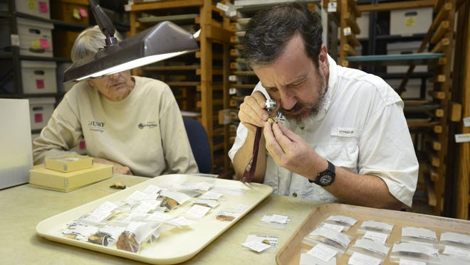 John Worth, associate professor of historical archaeology with UWF Department of Anthropology, looks at a pottery sherd found at a historic site that is the oldest established European multi-year settlement in the United States.