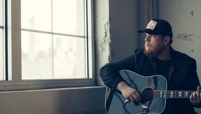 """Luke Combs' debut single """"Hurricane"""" was a platinum-selling, multi-week No. 1 song before his debut album """"This One's for You"""" was released in June of 2017."""