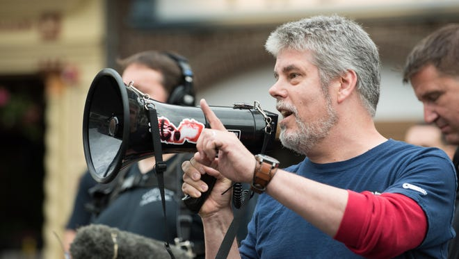 Michael Zapcic, from 'Comic Book Men,' thanks fans as they line up to set a Guinness world record and celebrate the 20th anniversary of Jay and Silent Bob's Secret Stash Comic Book Store.
