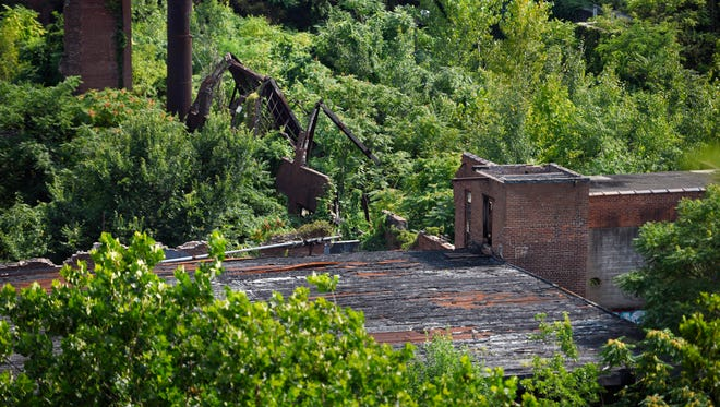 Ruins of industrial buildings within the borders of the national park at the Great Falls on Thursday.