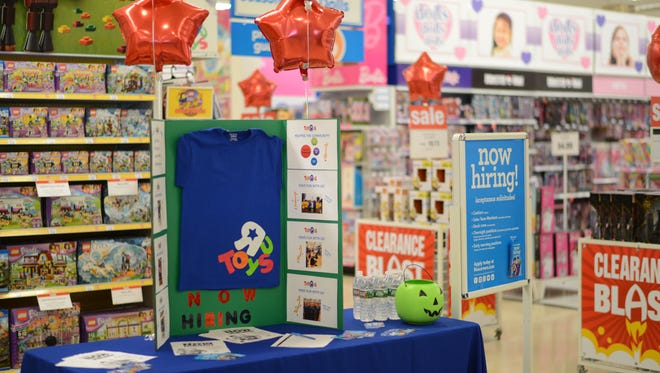 A holiday jobs recruitment table last October at the Toys R Us in Totowa. In New Jersey this year, the chain expects to hire about 1,800 part-time holiday workers.
