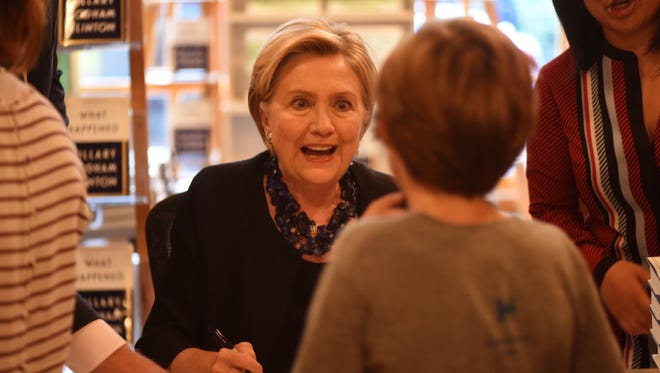 """Hillary Clinton is shown during a signing for her new book, """"What Happened."""""""