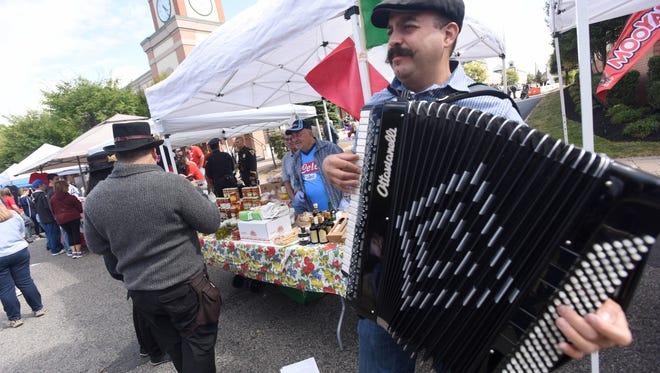 Filippo Saglimbeni plays his accordion for Lyndhurst Italian-American club during  Lyndhurst centennial celebration.