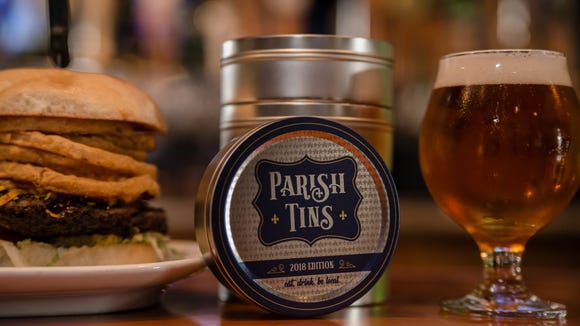 Parish Tins contain coasters that can be exchanged for $10 discounts toward things like this burger and beer from Walk-On's Bistreaux & Bar.