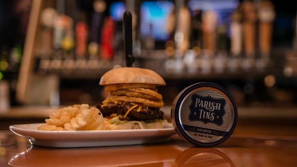 Parish Tins contain coasters that can be exchanged for $10 discounts to restaurants such as Walk-On's.