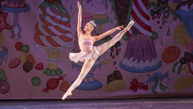 Kelly Angelina Bartolozzi dances an arabesque in the Vineland Regional Dance Company's production of 'The Nutcracker.' It is the company's 40th year producing the ballet.