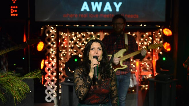 Miriam Fleming speaking at the Giving Christmas Away, Church Alive's Christmas service.