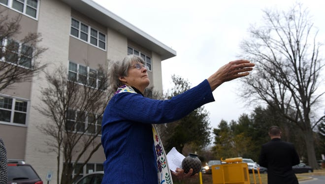 Rev. Barbara Gerlach sprinkles holy water as she blesses an abortion clinic in Bethesda, Maryland on January 29.
