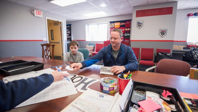Michael Nolan pays his $225 registration fee on Saturday, Feb. 17, 2018, for 11-year-old son Matthew, who will be playing in the Holbrook Little League in Jackson this year.
