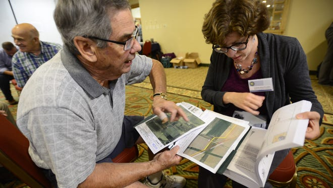 Edmund Miller talks to Joanne Wachholder with the Federal Energy Regulatory Commission about his concerns with the proposed NEXUS pipeline that would go through his Luckey Road property, a family farm for 200 years, in Wood County at an August 2016 meeting held in Fremont. The NEXUS pipeline is expected to be operational by this fall.