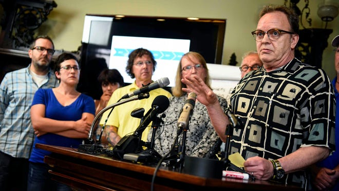 Jamie Heutmaker, far right, a victim of clergy sexual abuse, addresses media alongside other victims and family members during a press conference detailing the settlement reached between the Archdiocese of St. Paul and Minneapolis and clergy abuse survivors at the office of attorney Jeff Anderson, Thursday, May 31, 2018, in St. Paul, Minn.