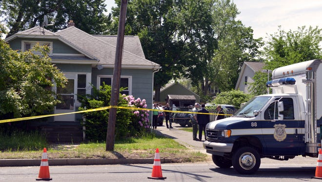Springfield Police work at the scene where two bodies were found in Springfield, Mass., a house connected to Stewart Weldon, currently being held on other charges.
