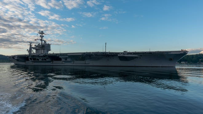 The USS John C. Stennis transits the Puget Sound as it departs Bremerton to conduct routine training as it prepares for its next scheduled deployment.