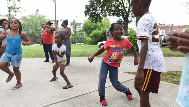 Kids participate in a dance contest as community groups are having a celebration at Barbour park for neighborhood people..