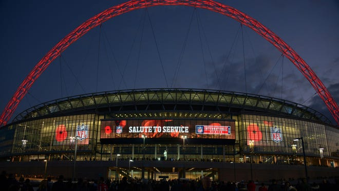 General view of the NFL Salute to Service logo and remembrance poppys on the Wembley Stadium marquee before the NFL International Series game between the Dallas Cowboys and the Jacksonville Jaguars.