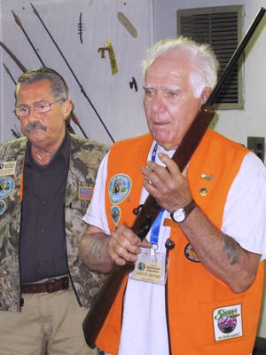 Master instructor Charles Bertani, right, demonstrates safe gun handling techniques during a hunter safety course at the Chemung County Rod and Gun Club. Looking on is instructor Tony Marino.