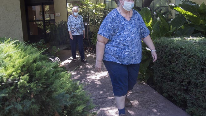 Kathy Geimer, 67, right, and Bertha Miquel,, 84, walk around  the Oaks at Inglewood senior living facility in Stockton while participating in the facility's pedometer challenge.