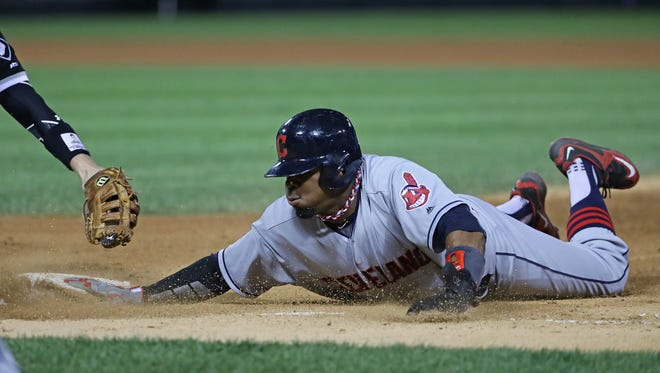 Rajai Davis #20 of the Cleveland Indians dives back into first base ahead of the tag in the 6th inning against the Chicago White Sox at U.S. Cellular Field on September 14, 2016 in Chicago, Illinois.