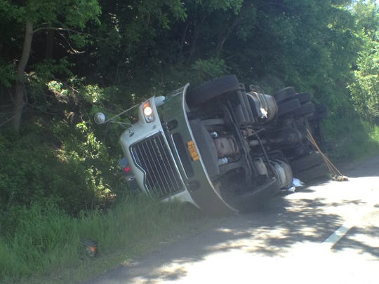 This truck toppled on Route 9 in Peekskill, dumping trash and closing one lane.
