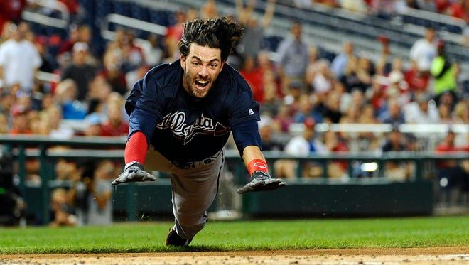 Atlanta Braves shortstop Dansby Swanson (2) dives home to score an inside the park home run against the Washington Nationals on Sept. 6, 2016.