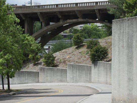 Retaining walls are seen along Volunteer Landing Lane on Tuesday, May 3, 2016.