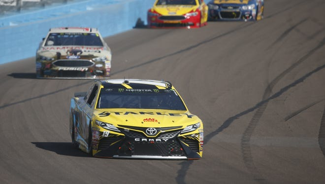 Joe Gibbs Racing's Daniel Suarez (19) comes around turn one in lap 40 during the Can-Am 500 on Sunday, Nov. 12, 2017 at Phoenix International Raceway in Avondale, Ariz.
