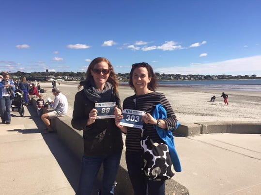 My friend, Karen Howe, and I getting our bibs for the Newport, Rhode Island, marathon.