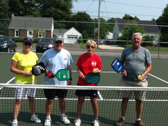 Brockport residents at the new pickleball courts at the Barry Street Park, from l, Barb Sciremammano, Losh Spalla, Carol Brakenbury, and Jim Bolthouse photo provided by Hanny Heyen
