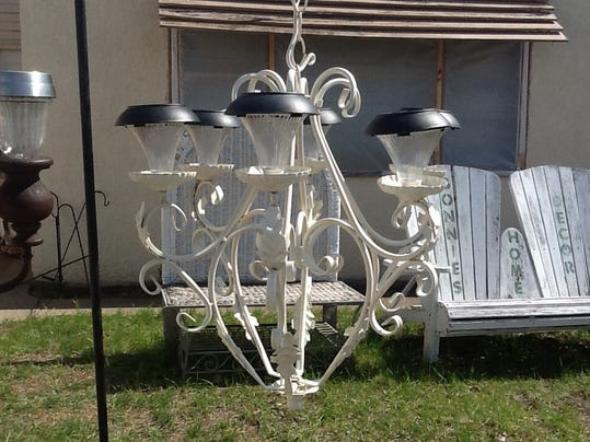 Diy solar chandelier gives outdoor space a soft glow for Solar light chandelier diy