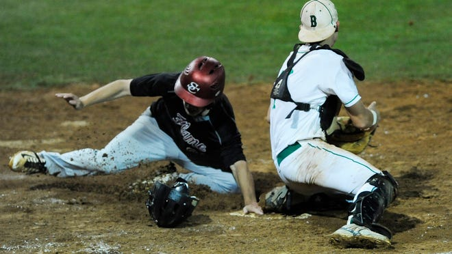 Shoals Christian's Tanner Bozeman is safe at home as Brantley's Tate Tatum tries to tag him out at home in the first game of the 1A baseball championship series at Paterson Field on Tuesday.
