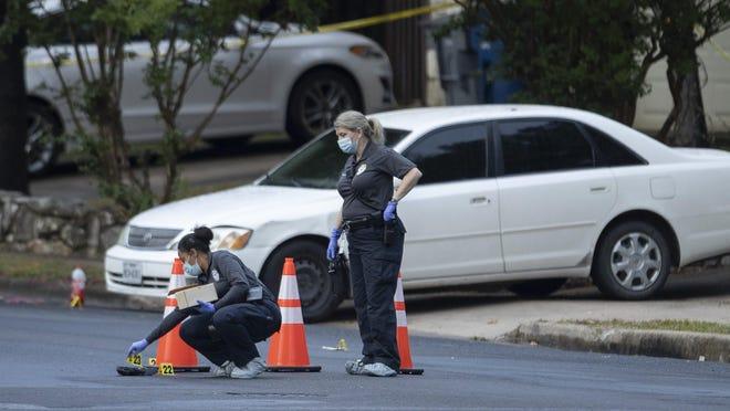 Austin police investigate the scene of a homicide in the 3800 block of Alexandria Drive on Saturday.