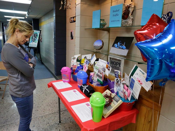 Cathy Farrell of Kohler looks over raffle items at