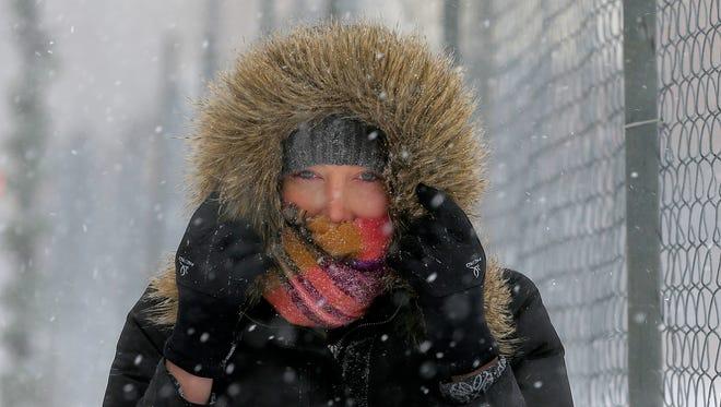 Morgan Foster walks in the wind and snow along W. Main Street in Somerville, N.J.  Jan. 4, 2018.
