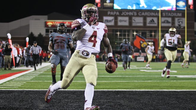 Florida State's Dalvin Cook silenced the Louisville crowd with this late fourth quarter touchdown to put the Seminoles up 35-31 over the Cards. FSU won the game, 42-31. Oct. 30, 2014 By Matt Stone/The C-J