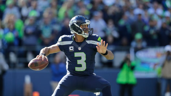 Seattle Seahawks quarterback Russell Wilson passes against the Chicago Bears in the second half of an NFL football game, Sunday, Sept. 27, 2015, in Seattle.