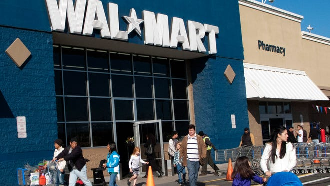 Customers walk outside a Walmart store in Norwalk, Conn.