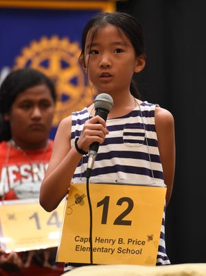Capt. Henry B. Price Elementary School fourth grader Vivian Wen spells a word during the 45th Annual Scripps Regional Spelling Bee Competition at Sheraton Laguna Guam Resort in Tamuning on Mar. 4, 2017.