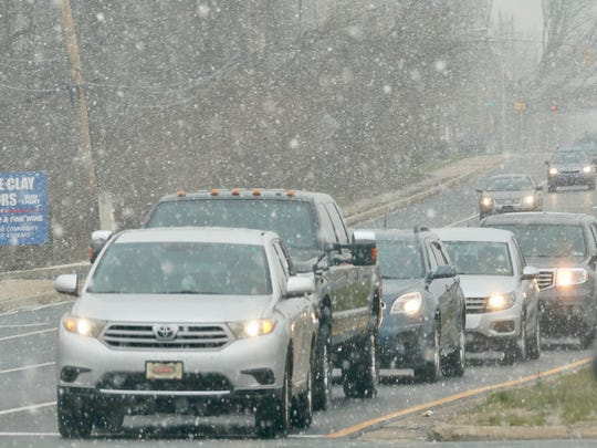 Snow begins to fall on Tuesday morning as motorist make their way along Rt.  4 Near Harmony Rd.