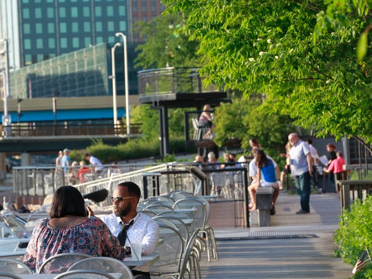 Customers dine along the RiverWalk in the Historic Third Ward.
