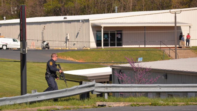 A Virginia State Trooper creates a perimeter with other officers, along with Staunton Police Department, during an incident on Wednesday, April 13, 2016 near the Staunton Mall.